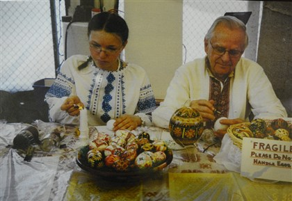 2014413RARmagukraine4 At age 11, Eryna Honchar demonstrates how to paint Ukrainian Easter eggs with Michael Haritan at a folk festival.