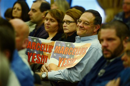 "20140415bwDrillLocal02-1 Bev Jordan of West Deer, along with Ed Valentas of Monroeville support drilling with signs saying, ""Marcellus Yes"" as they attend Allegheny County Council's public hearing Tuesday at the Allegheny County Courthouse."