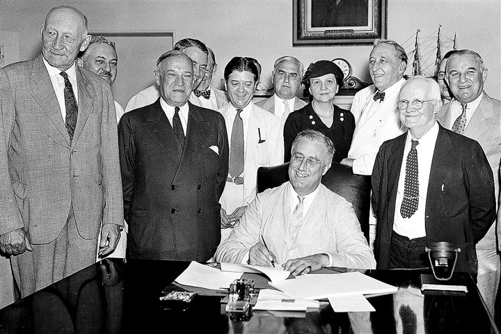 Historical image: FDR signs Social Security Bill, 1935 This Aug. 14, 1935 photo shows President Franklin D. Roosevelt signing the Social Security Bill in Washington.
