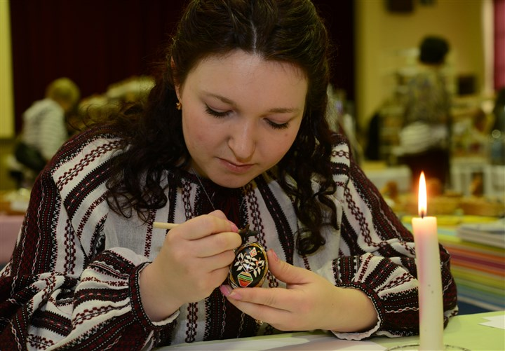 2014413RARmagukraine2-1 Eryna Honchar, 24, demonstrates how she paints intricate Ukrainian Easter eggs during a sale at St. Peter & St. Paul Ukrainian Orthodox Church in Carnegie.