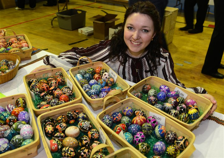2014413RARmagukraine1 Eryna Honchar shows some of the Ukrainian eggs she painted that are for sale at St. Peter & St. Paul Ukrainian Orthodox Church in Carnegie. Ms. Honchar was an orphan in Ukraine who was adopted by a couple in Carnegie when she was 9.