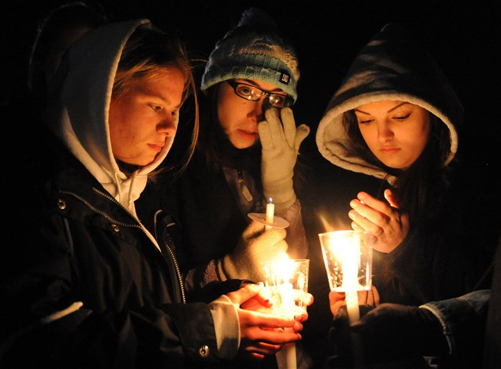 20140415JHLocalVigil02-1 Franklin Regional High School students, from left, Nellie Beasley, Maggie Murphy and Kate Pickup pray Tuesday during a back-to-school vigil at the Murrysville Community Park. Students at the high school will return to class today. Classes have been canceled since a knife attack last Wednesday.