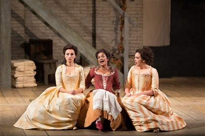 "20140416hocosiBmag-1 Isabel Leonard, Danielle de Niese and Susanna Phillips in Mozart's ""Così fan tutte,"" a production brought to local theaters by The Met: Live in HD series."