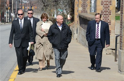 20140416dsWilkinsburgLocal01 Officals from the Allegheny County District Attorney's office leave Wilkinsburg Middle School.