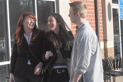 South Fayette bullying charges Shea Love, Ellisen Lowe, and Christian Stanfield celebrated Wednesday outside Bubba's Gourmet Burghers in South Fayette after an announcement that wiretap violation charges against Christian were to be withdrawn.