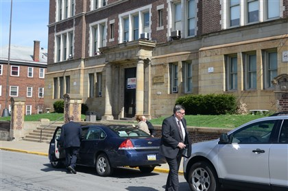 20140416dsWilkinsburgLocal02-1 Officals from the Allegheny County District Attorney's office leave Wilkinsburg Middle School.