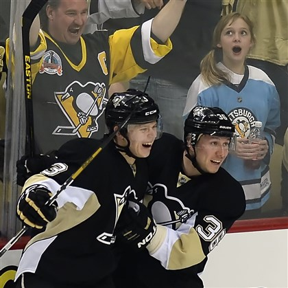 maatta0419 Penguins winger Jussi Jokinen is congratulated by Olli Maatta after scoring against the Blue Jackets in the first period Wednesday night at Consol Energy Center.