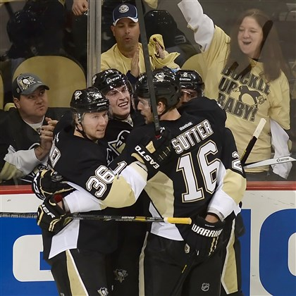 20140416mfpenssports05-1 The Penguins' Beau Bennett is congratulated by Jussi Jokinen, Brandon Sutter and Matt Niskanen after scoring against the Blue Jackets in the second period Wednesday night of Game 1 of this first-round series of the Stanley Cup Playoffs at Consol Energy Center.