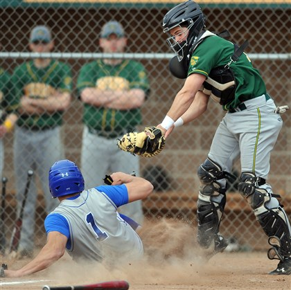 20140410MWHbaseballSports07.jpg Hempfield's Joey DeFloria slides home with a run despite the efforts of Penn-Trafford catcher Scott Koscho. That was one of the few low points for the Warriors as they dispatched the Spartans, 13-2, last Friday in a Section 2-AAAA victory.
