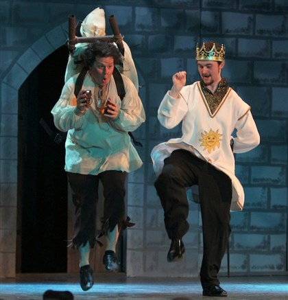 "2014KellySpamalotCC0416 Michael Zak as Patsy and Nathaniel Yost as King Arthur look on the bright side of life in Central Catholic High School's production of ""Spamalot."""