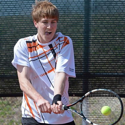 20140408mftennissports06.jpg Latrobe's Chad Kissell returns a shot against Central Catholic's Adam Blasinsky in the WPIAL tournament.