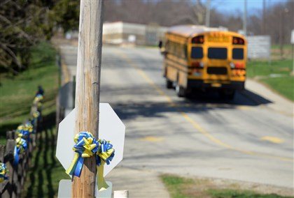 20140416bwFranklinLocal01 Ribbons in Franklin Regional High School's blue and gold colors adorn a utility pole and fence posts at the school's driveway in Murrysville on Wednesday.