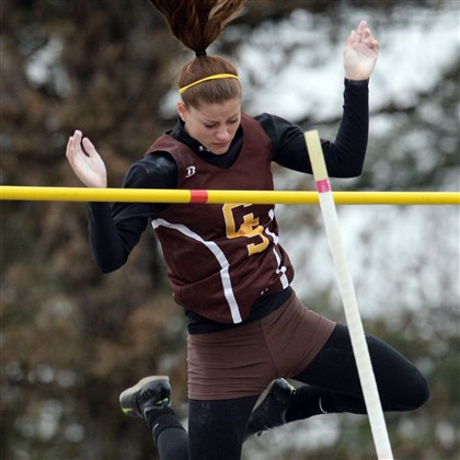 20140411mftracksports06.jpg Greensburg Salem's Courtney McQuaide competes in the pole vault at the Butler Invitational Friday afternoon. She set a meet record with a vault of 11 feet, 10 inches.