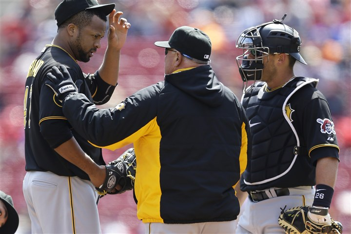 Pirates Reds Baseball.JPEG-.38-2 Pirates starting pitcher Francisco Liriano talks with pitching coach Ray Searage in the first inning against the Cincinnati Reds. Catcher Tony Sanchez is on the right.