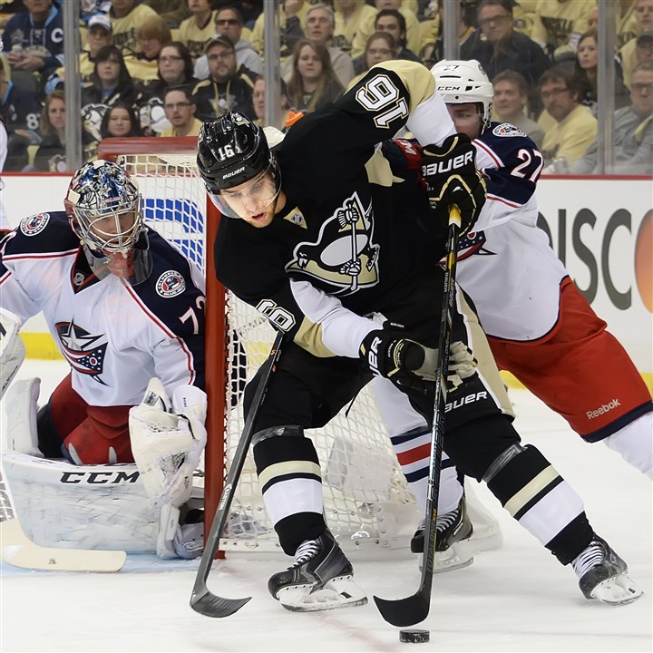 20140414pdPenguinsSports03-2 The Penguins' Brandon Sutter wraps the puck around the net against the Blue Jackets at Consol Energy Center.