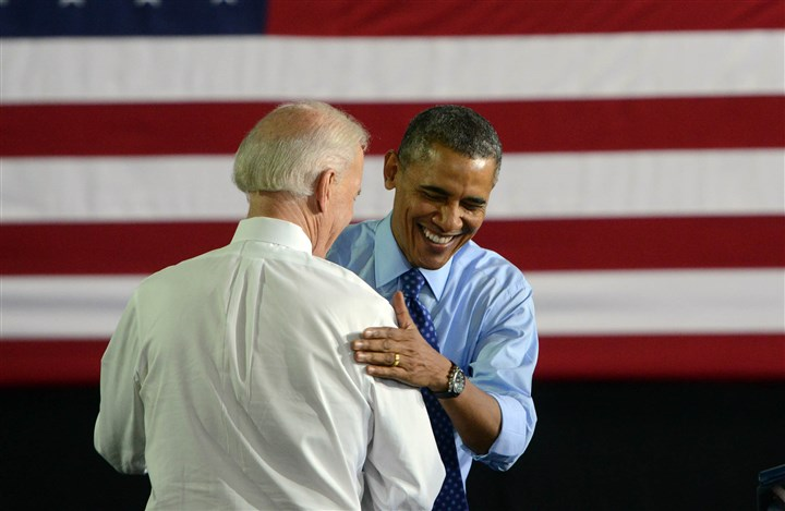 20140416MWHobamaLocal10-7 President Barack Obama and Vice President Joe Biden share a light moment on stage Wednesday at Community College of Allegheny County's West Hills Center in North Fayette.