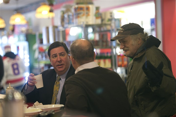 Peduto at Michelle's Diner in Allentown A customer, right, joins a conversation between the mayor, left, and Councilman Bruce Kraus while the two have lunch in January at Michelle's Diner in Allentown.
