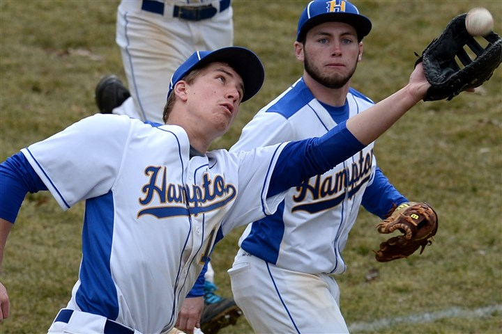 20140327mfbethelsports05.jpg Hampton's Steve Dayton pulls in a fly ball during a non-section game against Bethel Park March 27.
