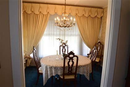 dining room's crystal chandelier  With so many windows and a crystal chandelier, dining room is a bright, light-filled room