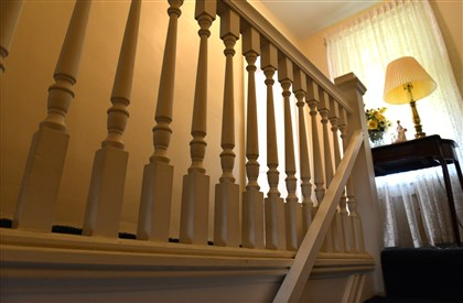 Wooden spindles run along the hallway. Wooden spindles run along the hallway.