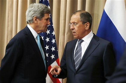 529034907 U.S. Secretary of State John Kerry talks with Russian Foreign minister Sergei Lavrov at the start of a bilateral meeting to discuss the ongoing situation in Ukraine on Thursday in Geneva.