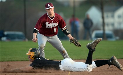 hshigh2 Montour's Trent Vietmeier gets into second base safely against Ambridge's Shawn Holman Thursday night.