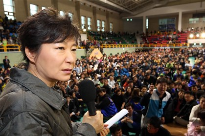 South Korea Ship Sinking South Korean President Park Geun-hye speaks during a meeting with parents whose children are now missing in Ship Sewol at a gymnasium in Jindo, South Korea, on Thursday.
