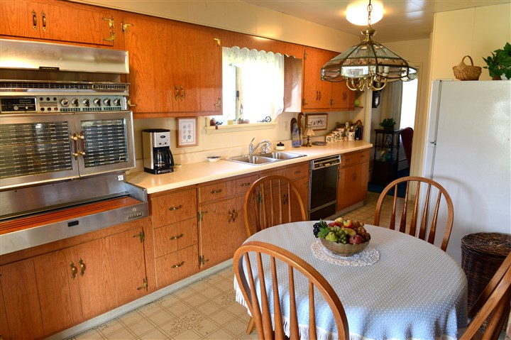 The kitchen has newer countertops The kitchen has newer countertops and solid wood cabinets.
