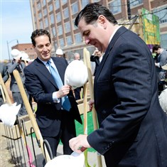 21040417ppBakerySq2.01BIZ Gregg Perelman, left, a managing partner for Walnut Capital, and Pittsburgh Mayor Bill Peduto collect their hard hats and shovels for the ceremonial groundbreaking for Bakery Square 2.0 on Thursday in East Liberty.