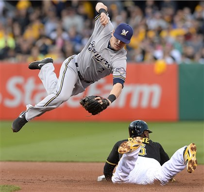 The Brewers' Scooter Gennett leaps over Starling Marte The Brewers' Scooter Gennett leaps over Starling Marte as he slides safely into second Friday night at PNC Park.