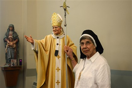 Sister Bernice Fiedor holds statue of Pope John Paul II Sister Bernice Fiedor holds the statue of Pope John Paul II at St. Anne Home in Greensburg. Sister Bernice spent many years at the Rome house of her Felician religious order, whose roots are in John Paul's native Poland. Before Cardinal Karol Wojtyla of Krakow became pope, she and another sister would regularly drive him to appointments during his visits to Rome.