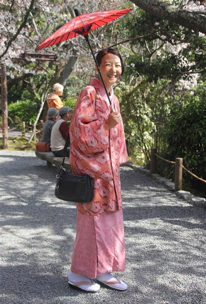 Japanese tour guide's kimono A Japanese tour guide in traditional attire. The kimono coat she is wearing was her mother's.