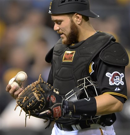 Russell Martin looks at the baseball  Russell Martin looks at the baseball that the Brewers' Martin Maldonado knocked the cover off on a ground ball hit to Pedro Alvarez in the sixth inning Friday at PNC Park.