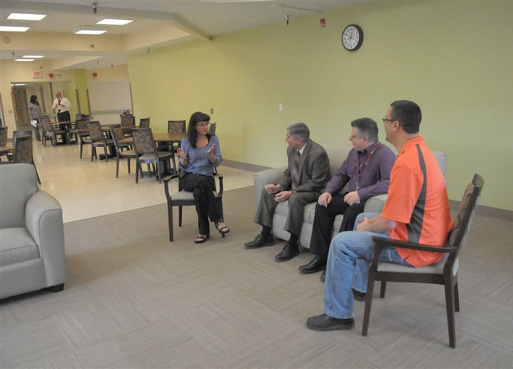 Memory Care Unit at Kane Regional Center From left, Melissa Barcic, director of nursing; Dennis Biondo, executive director of all Kane Regional Centers; Neil Bowser, administrator; and Vince Klingensmith, environmental services manager, try out the seating Friday in the dining and activity room in the new Memory Care Unit, due to open in May at Kane Scott Regional Center.