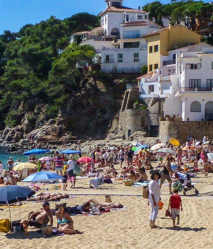 WLT-SPAIN-COSTABRAVA 4 MCT Cliffside inns, homes and restaurants climb the hill above the beach in Llfranc, Costa Brava, Catalonia, Spain.