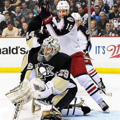 umberger0420 Penguins goalie Marc-Andre Fleury makes a save on Columbus' R.J. Umberger, a Plum native.