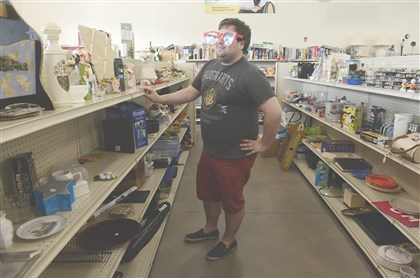 20140419bwGoodwillWest03-2 Drew Gaworski of Kennedy shops housewares at the new Goodwill Southwest Pennsylvania in Heidelberg.