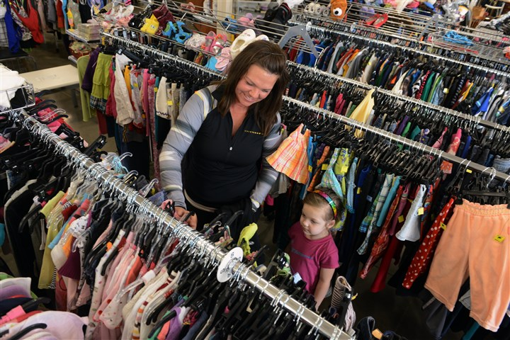 Goodwill4 Robyn Slivka of Green Tree shops with her daughter Josie, 4, at the new Goodwill Southwest Pennsylvania in Heidelberg.