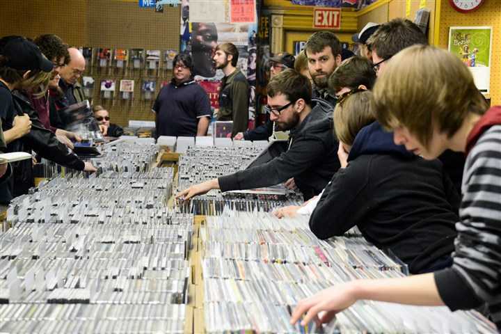 Record Store Day Jeff Shucosky, center, 24, of Shadyside, looks through rows of records with other customers at Sound Cat Records in Bloomfield on Saturday as part of the 7th Annual Record Store Day, which includes special releases available only in record stores.