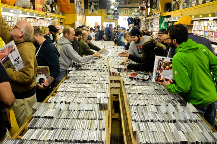 Record Store Day Customers dig through rows of records and disks at Sound Cat Records in Bloomfield Saturday.