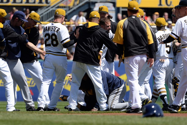 20140420mfbucssports04-3 Pirates and Brewers players clear the benches in the third inning Sunday at PNC Park.