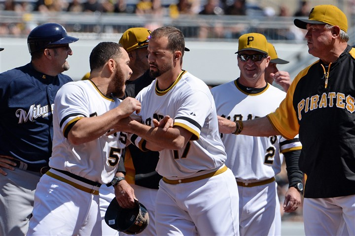 Pirates' catcher Russell Martin Pirates' catcher Russell Martin is held back by Gaby Sanchez after the benches cleared against the Brewers in the third inning Sunday at PNC Park.
