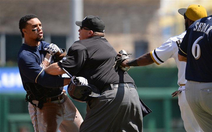 Gomez April 20, 2014  Brewers' Carlos Gomez is held back by third base umpire Jim Reynolds during the game against the Pirates in the third inning Sunday at PNC Park.