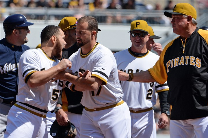 20140420mfbucssports03-2 Pirates' Russell Martin is held back by Gaby Sanchez after the benches cleared against the Brewers in the third inning Sunday at PNC Park.