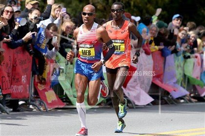 2014bostonmarathon2jpg-1 Meb Keflezighi, of the United States, leads Josphat Boit, also from the United States, passed Wellesley College during the 118th Boston Marathon Monday.