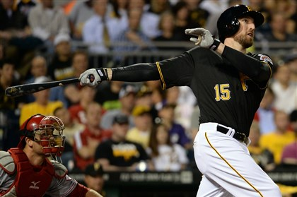 20140421mfbucssports07-2 The Pirates' Ike Davis hits a grand slam against the Reds in the fourth inning Monday at PNC Park.