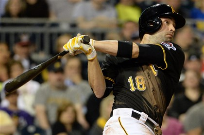Neil Walker hits a walk-off single Neil Walker hits a walk-off single to win the game against the Reds in the ninth inning Monday at PNC Park.