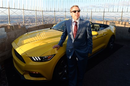 529010326 Ford Motor Company executive chairman Bill Ford poses with the 2015 Ford Mustang convertible April 16 as it is revealed at the top of the Empire State Building in New York. Fifty years ago, Ford Motors debuted its iconic Mustang at the 1964 World's Fair in New York City. To mark the occasion, the car company cut up one of its new cars into three pieces and reassembled it on the top of the Empire State building.