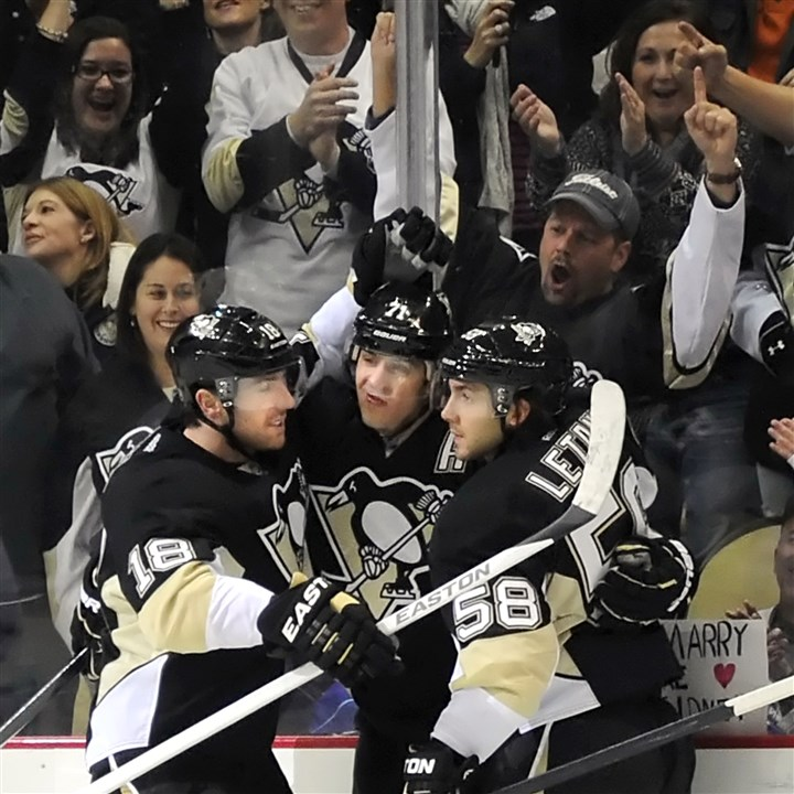 20140421malkinLatangNeal Evgeni Malkin is congratulated by James Neal and Kris Letang after scoring.