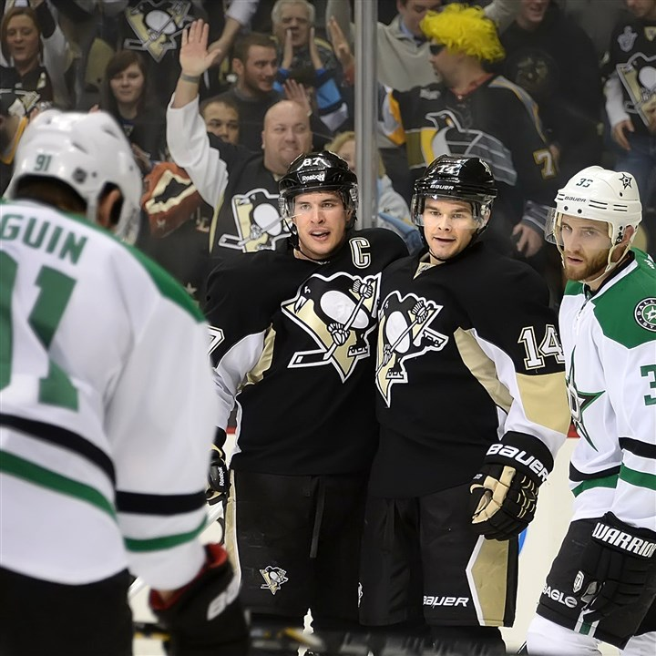 20140421crosbyKunitz Penguins Chris Kunitz celebrates with Sidney Crosby after scoring.
